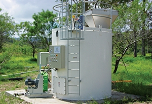 Vertical mixing tank equipment at mine site for mixing and dosing reagents (lime in this application) for the treatment of Acid Mine Drainage (AMD), Acid Rock Drainage (ARD) or other water quality issues.